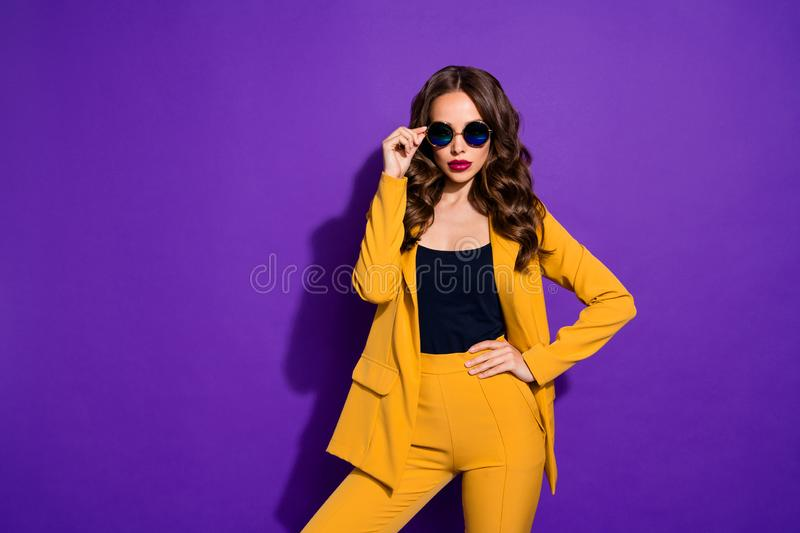 Photo of chic great businesswoman having made up her mind to found her own mega corporation while isolated with purple stock image