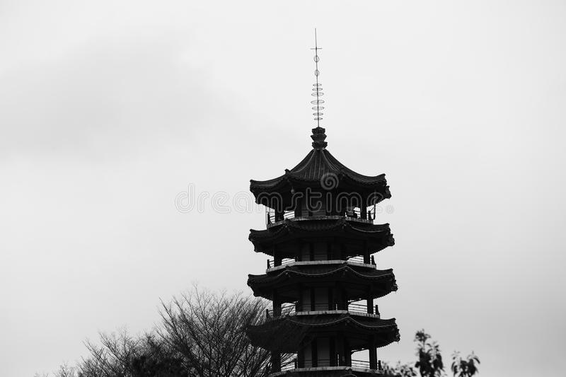 Black and white China Shenzhen Botanical Garden with Pagoda on Hill Surrounded by Forest Trees stock images