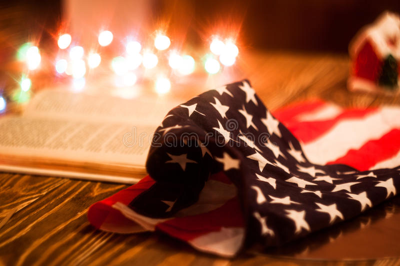 Photo christmas background with color lights. With american flag. Blurred background stock photo