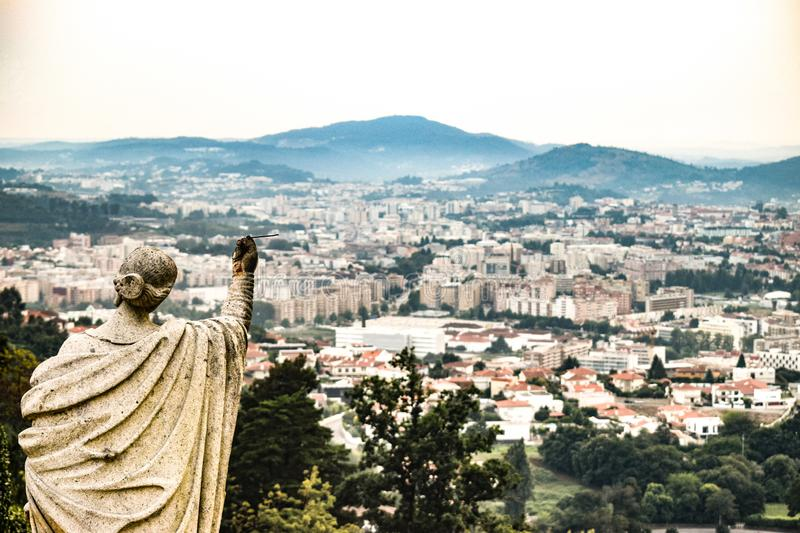 View from Bom Jesus of Braga. Photo of the city of Braga Portugal from the Church of Bom Jesus of Braga. I liked this photo because of the statue in the corner stock image