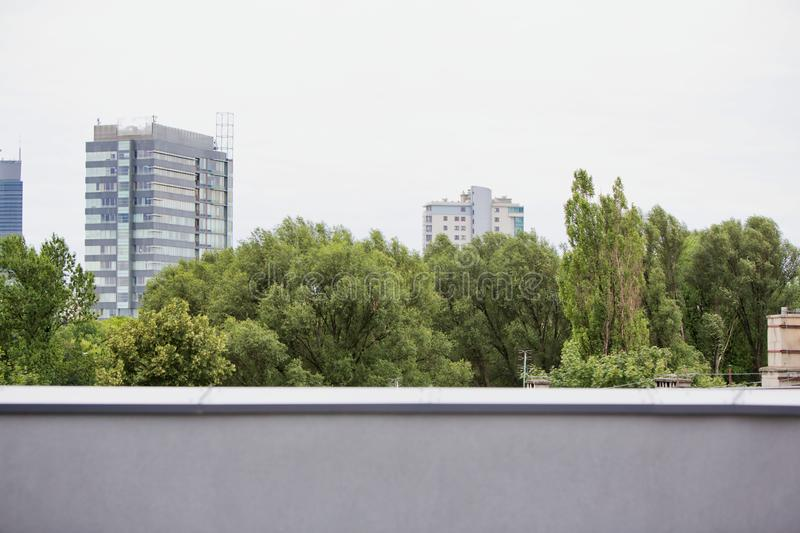 A city scenic of a contrasting, Wall building and trees. Photo of a city scenic of a contrasting, Wall building and trees royalty free stock photos