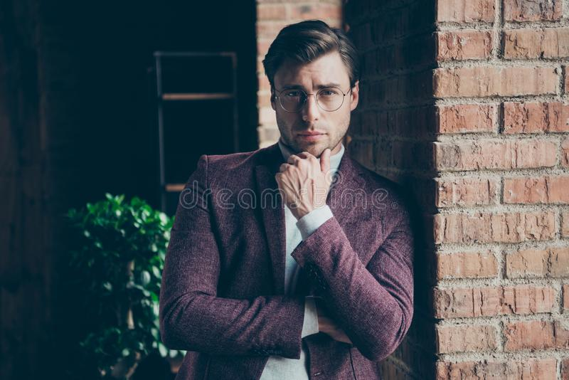 Photo of classy macho business guy looking clever eyes on camera holding hand on chin wear stylish blazer turtleneck royalty free stock photography