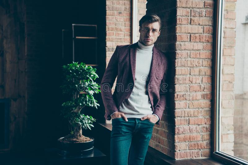 Photo of classy macho business guy looking clever eyes on camera wear stylish blazer turtleneck and jeans leaning wall stock photography