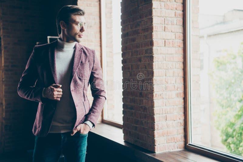 Photo of classy macho business guy looking window dreamy thinking about new startup wear specs stylish blazer turtleneck stock photo