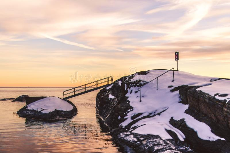 Photo of Cliff With Bridge and Snow stock images