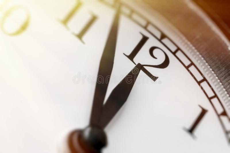 Photo of clock showing five minutes to noon royalty free stock image