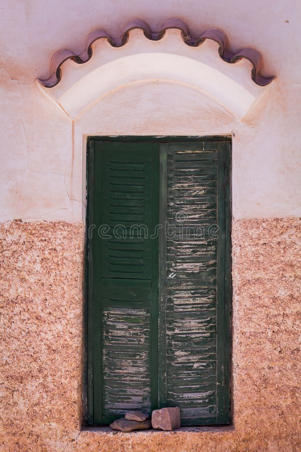Photo closeup of old aged building made of stone masonry with aged wooden door royalty free stock image