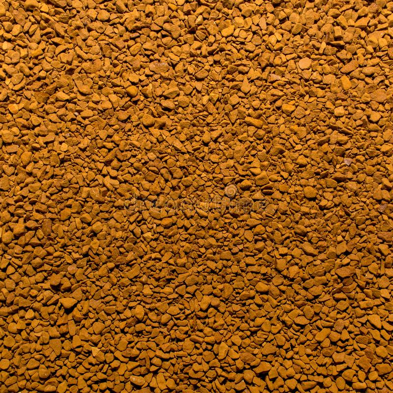 Photo of closeup texture of brown milled instant coffee, background stock photography