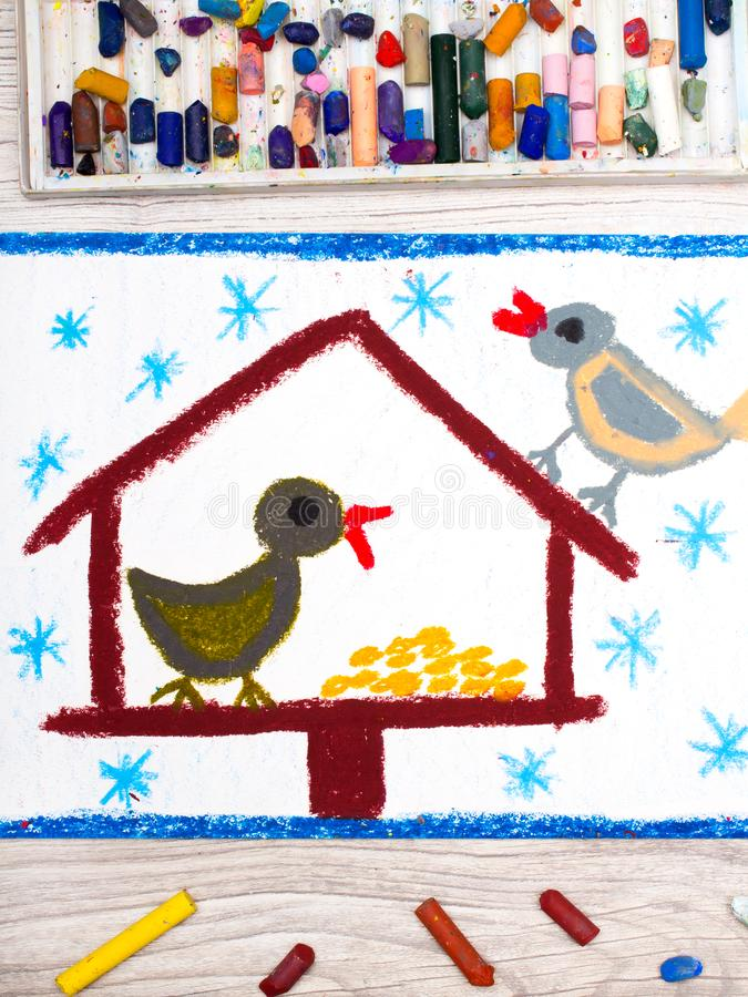 Colorful drawing: Bird feeder, winter and two cute birds. Feeder for the birds. Photo of colorful drawing: Bird feeder, winter and two cute birds. Feeder for the stock illustration