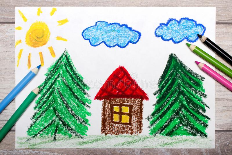 Colorful drawing: small house surrounded by coniferous trees. Photo of colorful drawing: small house surrounded by coniferous trees. House with red roof in stock image