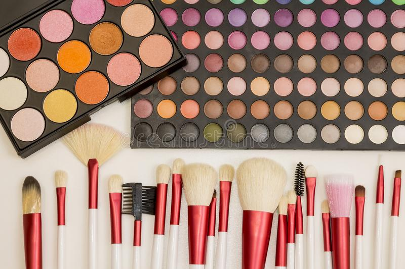 Colorful makeup set of eye shadows and brushes royalty free stock images