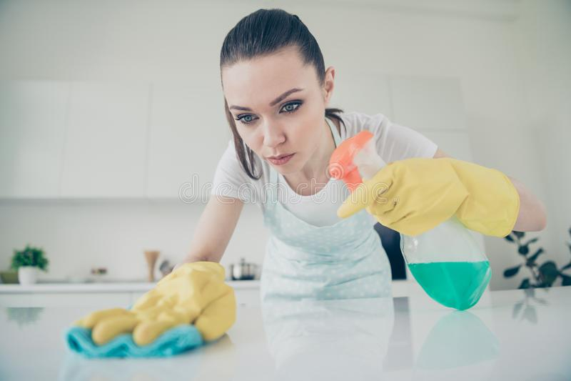 Photo of concentrated bothered woman getting tired of her routine work and planning life change in her mind royalty free stock photo