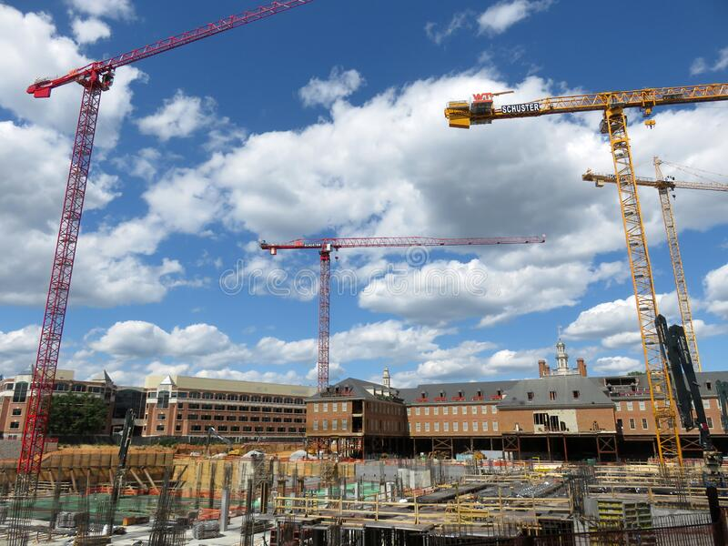 Construction Cranes in the Clouds stock images