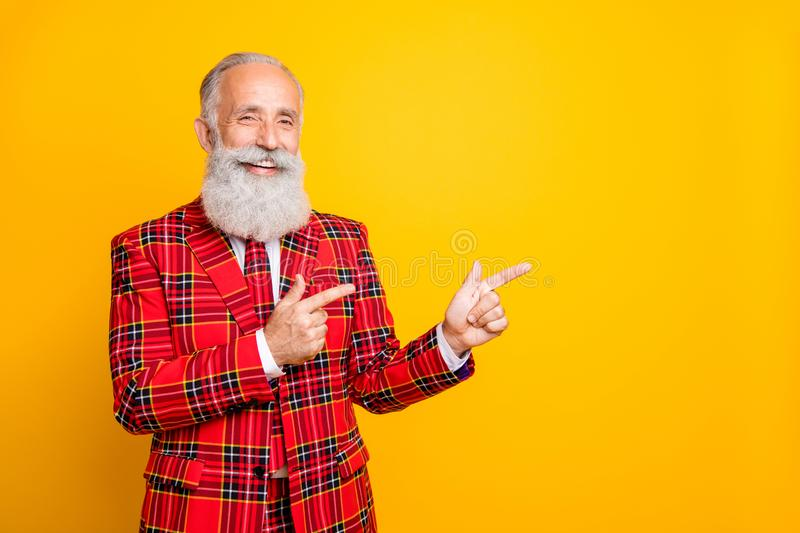 Photo of cool funny grandpa guy indicating fingers empty space salesman wear unusual lumberjack holiday suit red blazer royalty free stock image