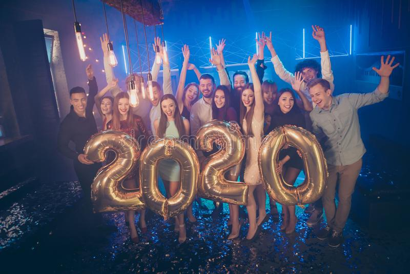 Photo of corporate party company crowd best friends holding big air balloons 2020 numbers counting last seconds to royalty free stock images