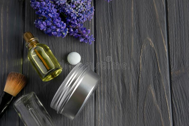 Photo of cosmetic brushes, cream, natural olia on a wooden background with space for copispeys. Beauty background for the spa royalty free stock photo
