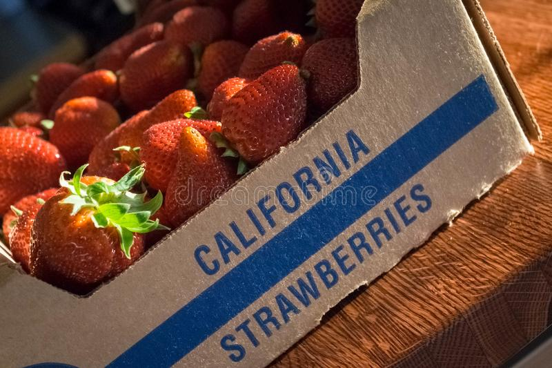 Photo of a Crate of California Strawberries. An image of a basket of strawberries with `California Strawberries` written on the side with blue lettering stock image