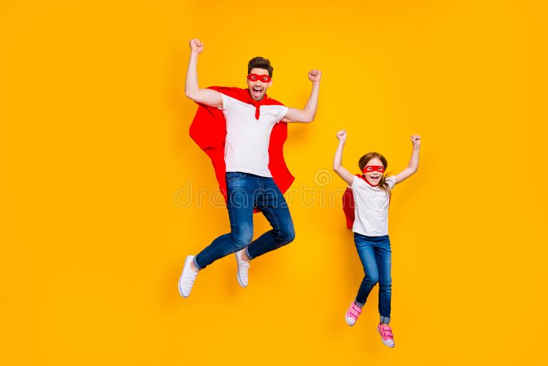 Photo of crazy daddy and foxy daughter playing cartoon characters wear superhero capes isolated yellow background. Photo of crazy daddy and foxy, daughter royalty free stock image