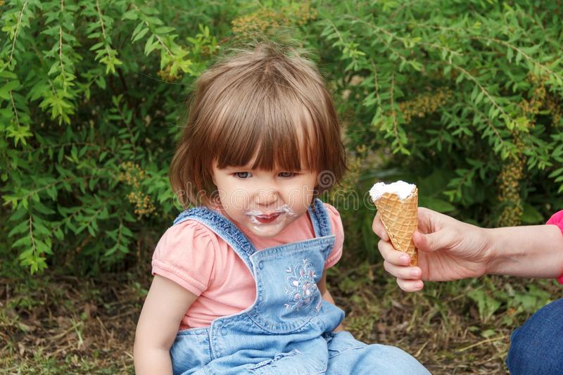 Cute girl with icecream mouth in summer. Photo of cute girl are eating icecream in summer royalty free stock photo