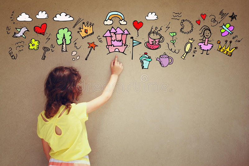 Photo of cute kid imagine princess or fairytale fantasy. set of infographics over textured wall background royalty free stock photo