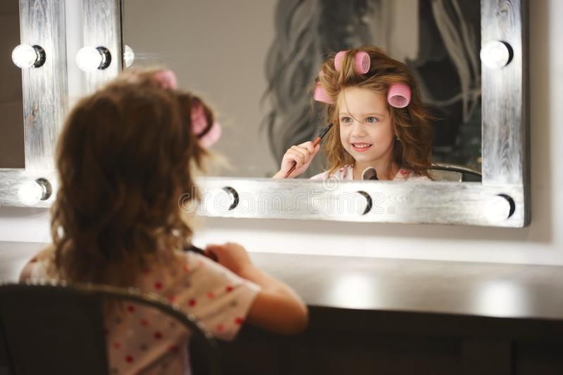 Cute little girl making make-up stock photography