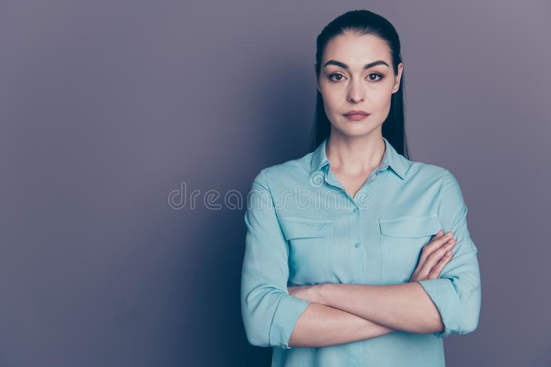 Photo of cute nice charming attractive boss standing confidently with her arms crossed pensively staring  over. Photo of cute nice charming attractive boss royalty free stock photography