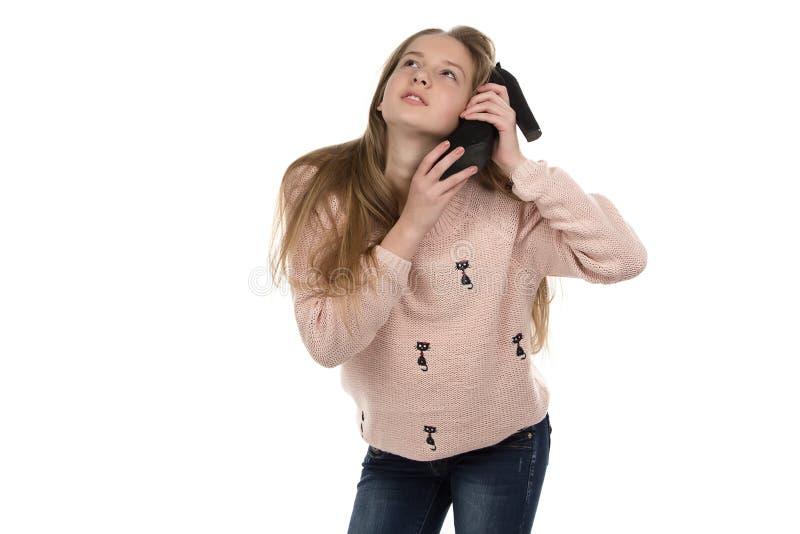 Photo d'adolescente avec la chaussure photographie stock libre de droits