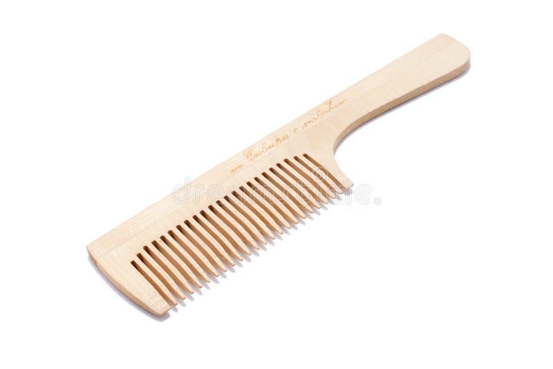 Photo d'un peigne en bois pour des cheveux photos libres de droits