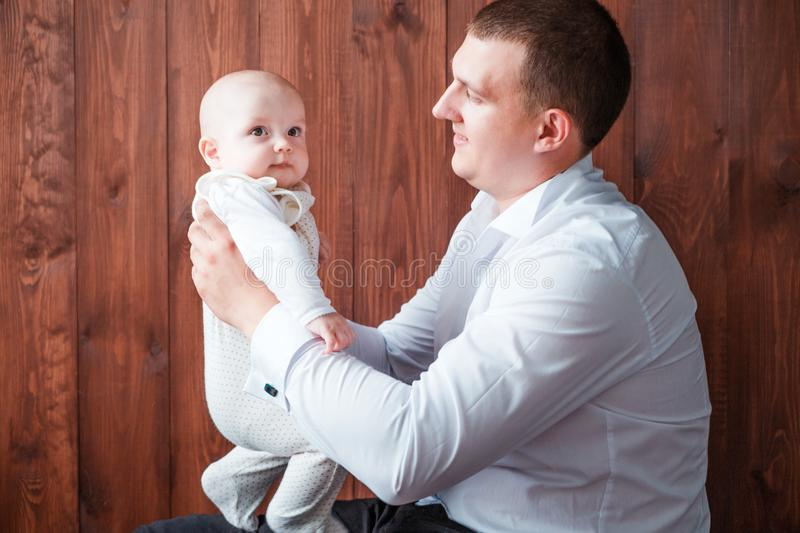 Dad with son posing on wooden background. Photo of dad with son posing on wooden background royalty free stock photo