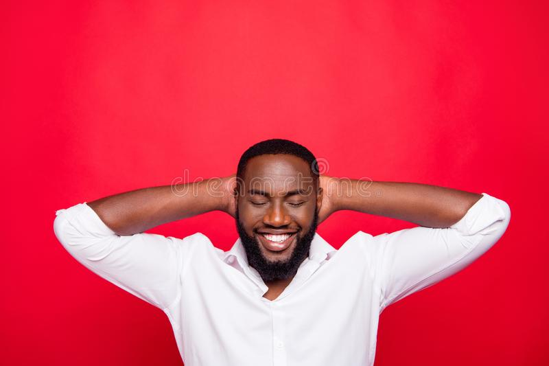 Photo of dark skin guy with closed eyes getting refreshment wear white shirt isolated bright red background. Photo of dark skin guy with closed, eyes getting stock image