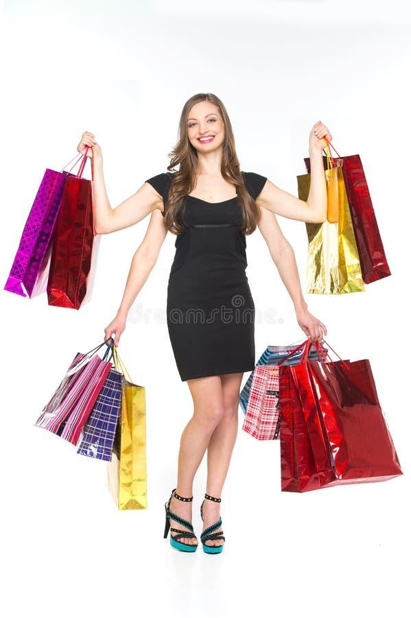 Photo de belle femme avec des paniers sur le blanc photos libres de droits