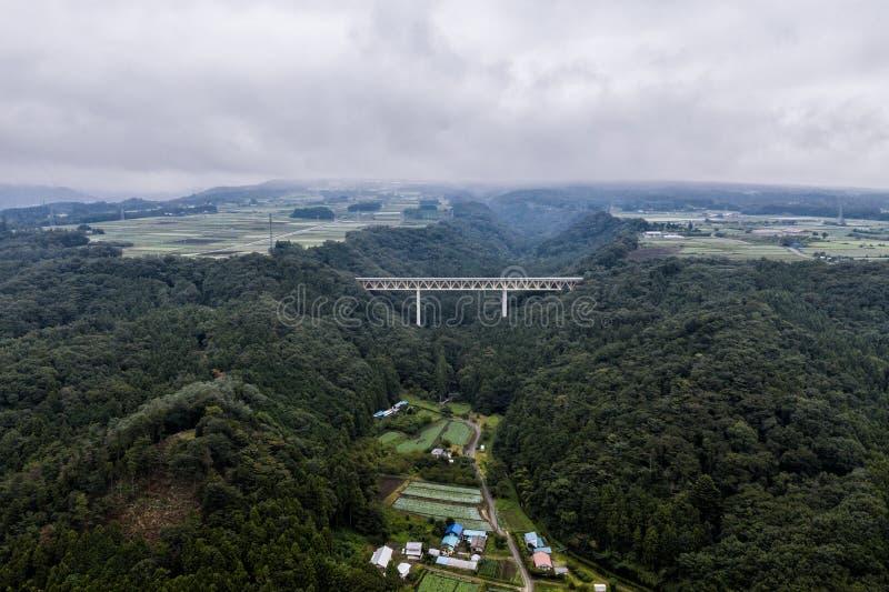 Photo de bourdon - montagnes, champs, et villages de préfecture de Gunma rurale japan photos stock