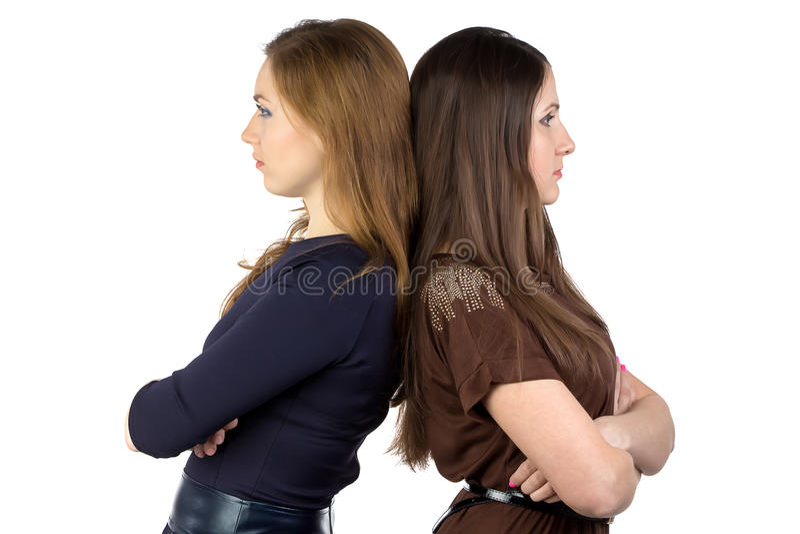 Photo de deux femmes dos à dos photographie stock