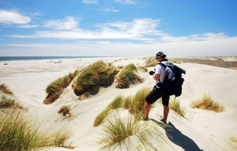 Photo de prise de touristes des dunes de sable d'adieu de broche photo libre de droits