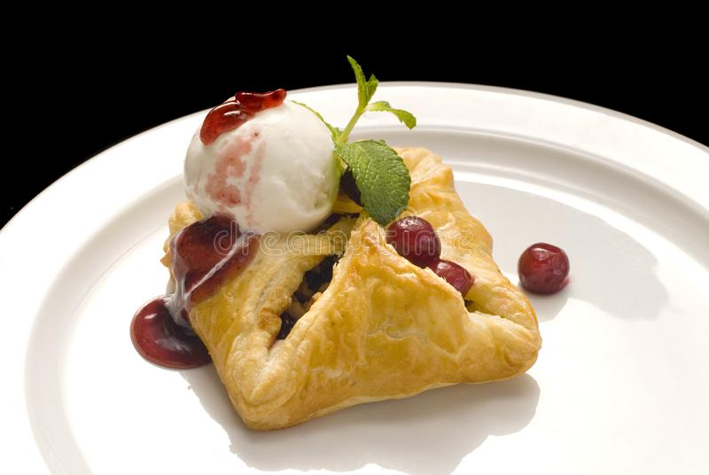 photo of delicious puff pastry with berries and ice cream stock image