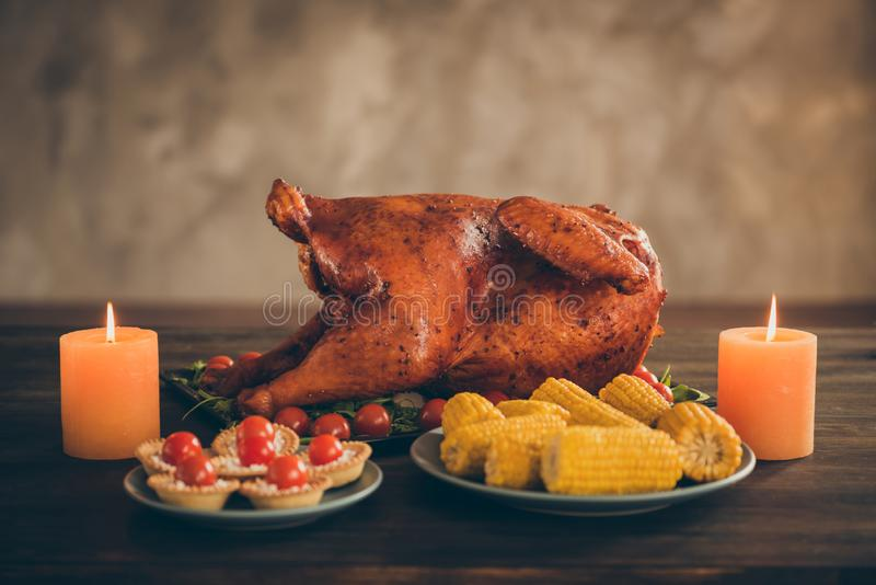 Photo of delicious tasty roast meat festive thanksgiving meal served with green garnish setting on wood table have corns royalty free stock image