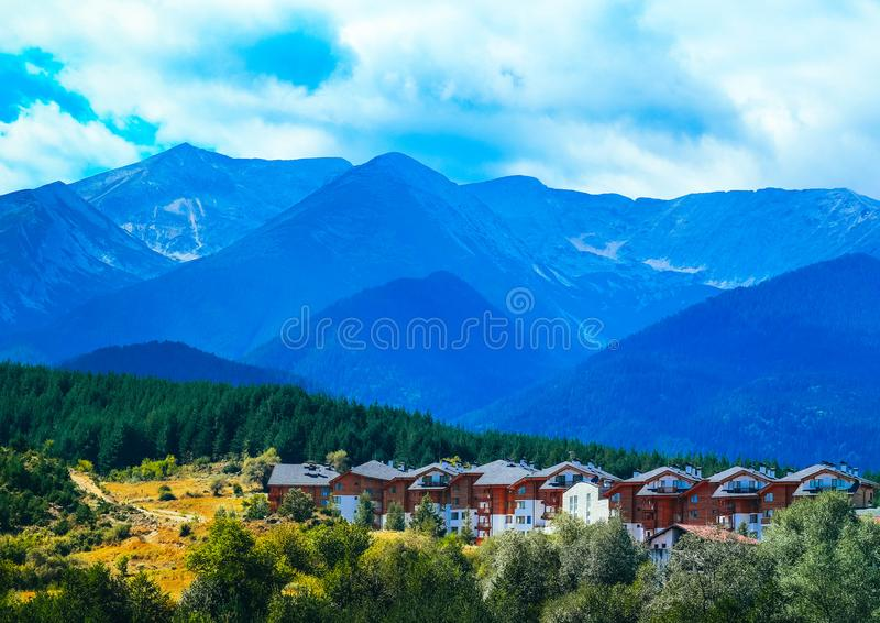 Photo depicting a beautiful colorful Bulgarian mountain village. Landscape, summertime. Europe, Bulgaria, rural village royalty free stock image