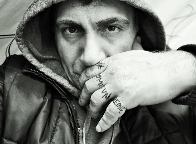Photo depicting a man with sweatshirt and hood. Photo depicting man sweatshirt hood stock photo