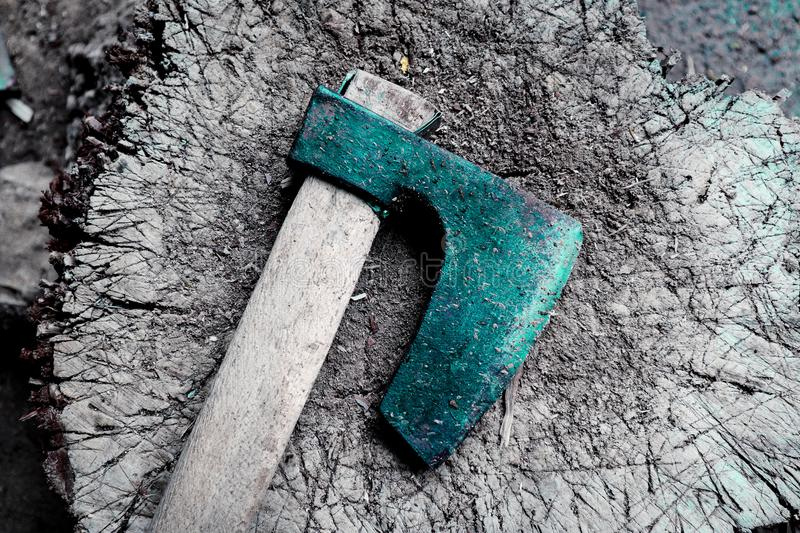 Photo depicts iron rusty but very sharp old wooden ax blade, pl royalty free stock photo