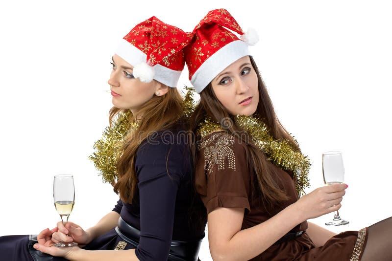Photo des femmes de pensée avec les verres images stock
