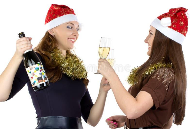 Photo des jeunes femmes avec les verres image stock