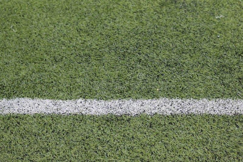 Photo des sports synthétiques verts d'une herbe images libres de droits