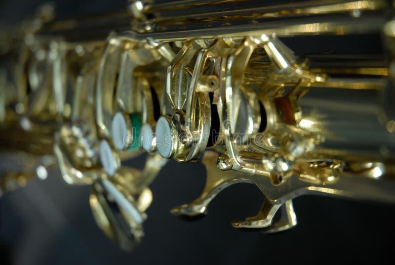 Tenor Saxophone detail. Photo of detailled parts of a Tenor Saxophone like axes, valves, etc stock photos