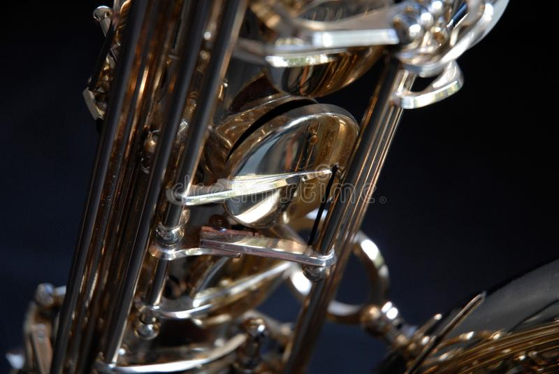 Tenor Saxophone detail. Photo of detailled parts of a Tenor Saxophone like axes, valves, etc stock photography