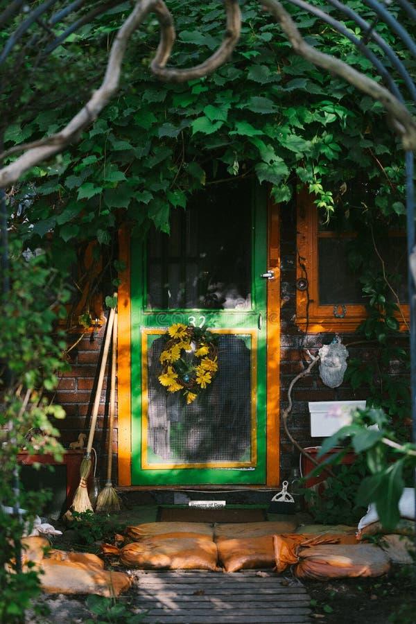 Photo of Door Near Plants royalty free stock image