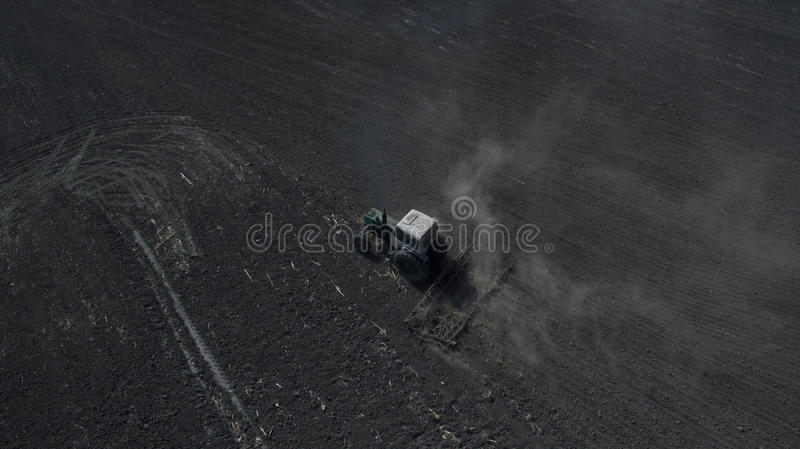 Photo from the drone tractor sows stock photo