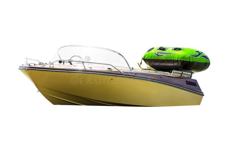 Photo du coupeur blanc de moteur avec le petit bateau vert d'air d'isolement sur le fond blanc photos libres de droits