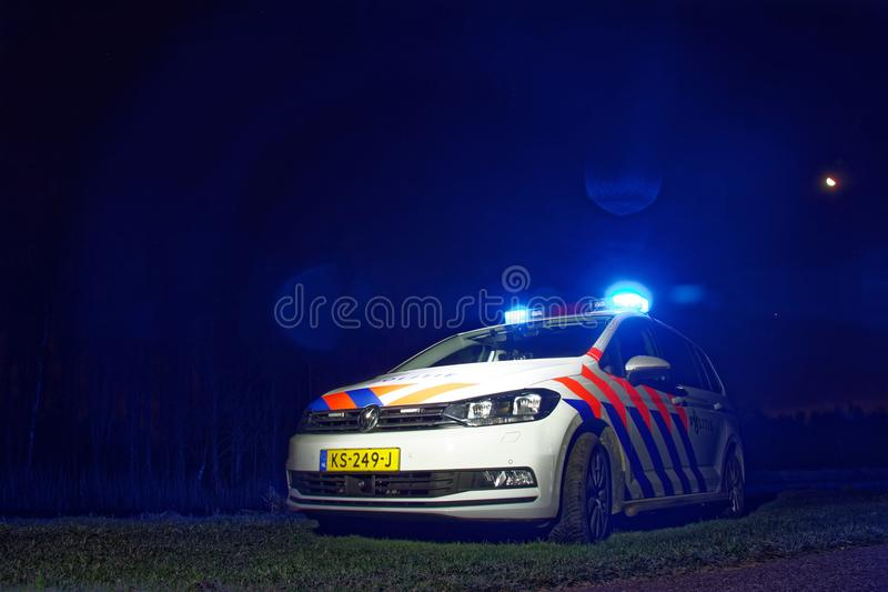 Dutch policecar at night, lights on royalty free stock images