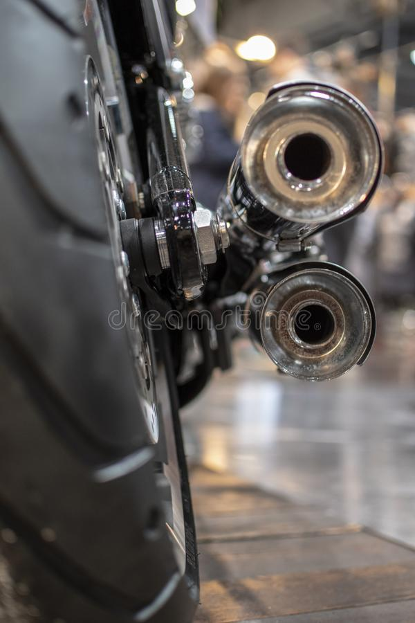The back of the motorcycle, the wheel and exhaust pipe, chromed and the speeder`s wheel royalty free stock images