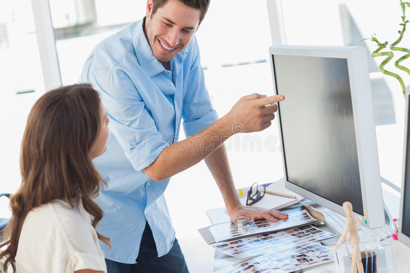 Photo editors working together on pictures stock photos
